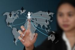 Woman looking at global map